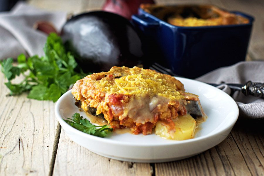 One partion of the creamy vegan Moussaka on a small white plate.
