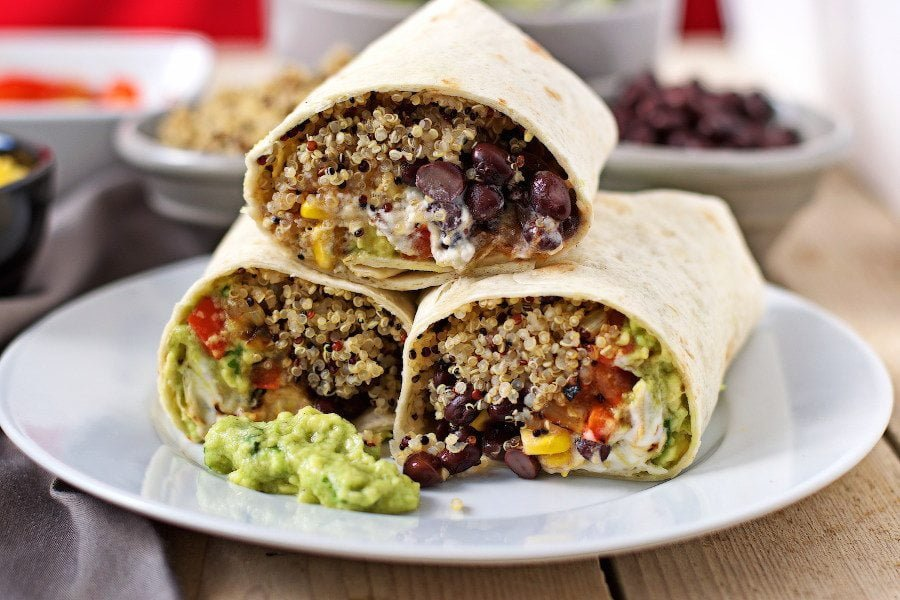 A stack of three Mexican Quinoa Wraps shown from the side, revealing the filling.