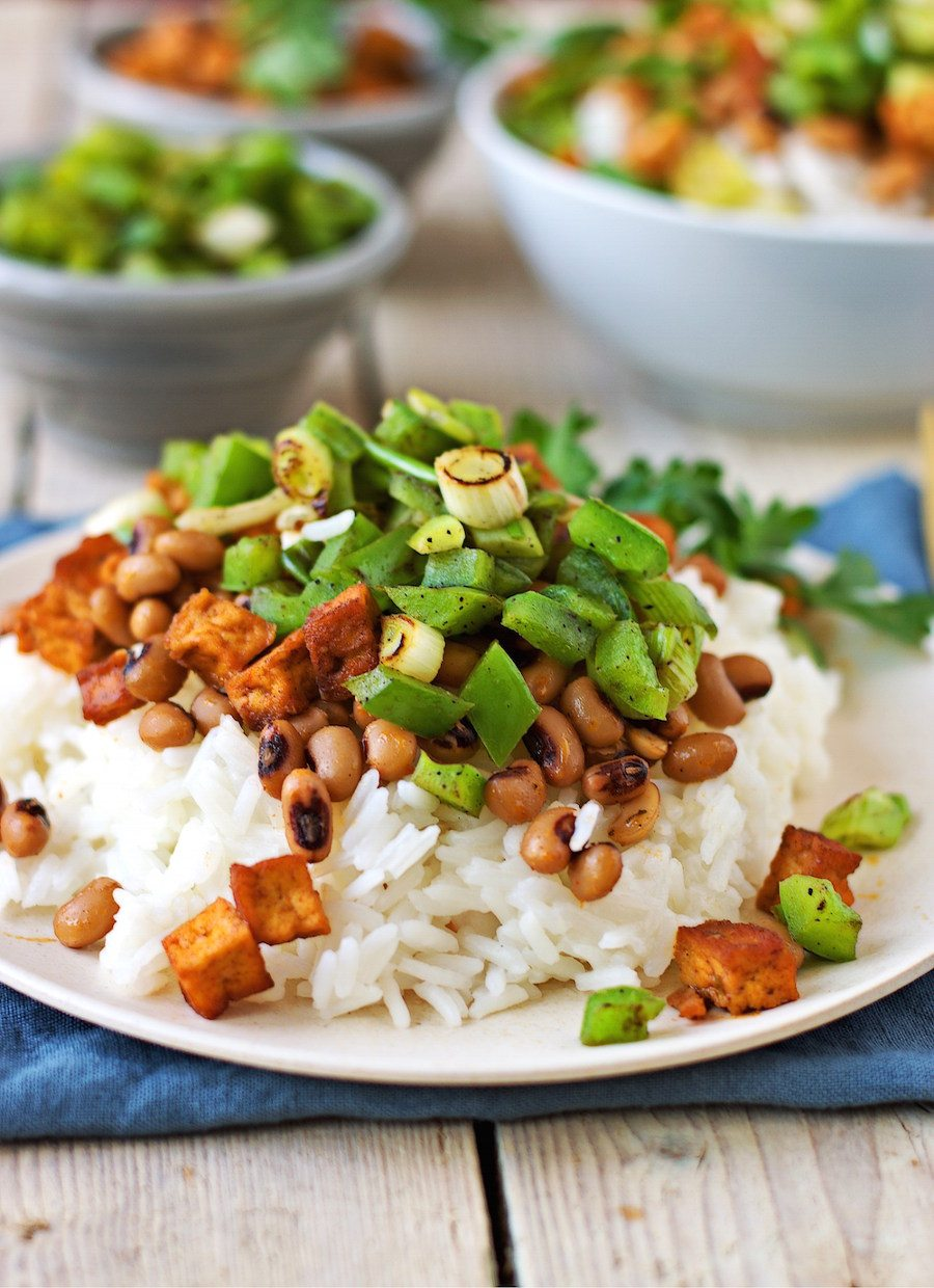 Closeup on the plate with Vegan Hoppin John showing the crunchy vegetables on a bed of rice.