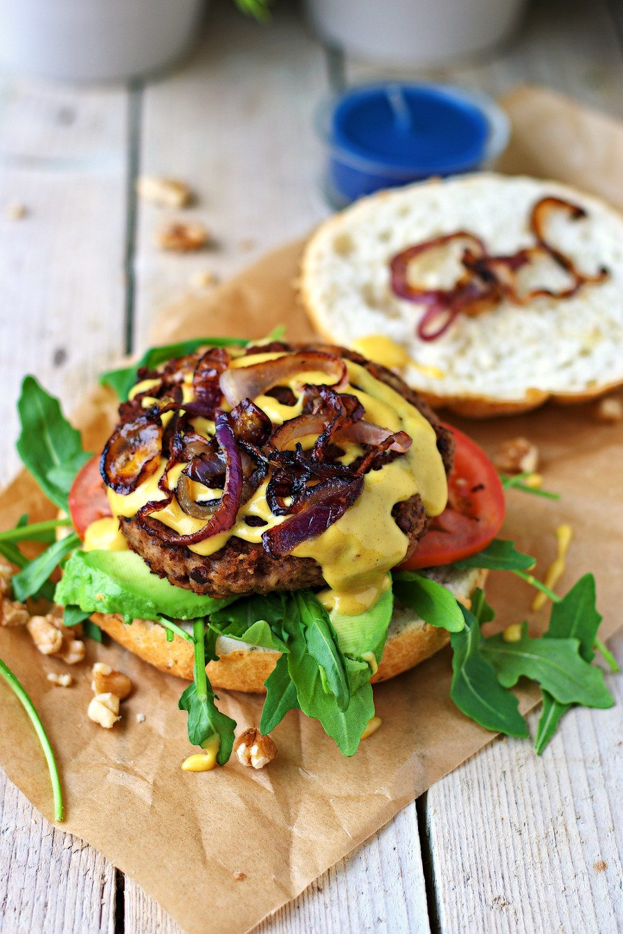 The Vegan Lentil Burger is topped with fried red onions.