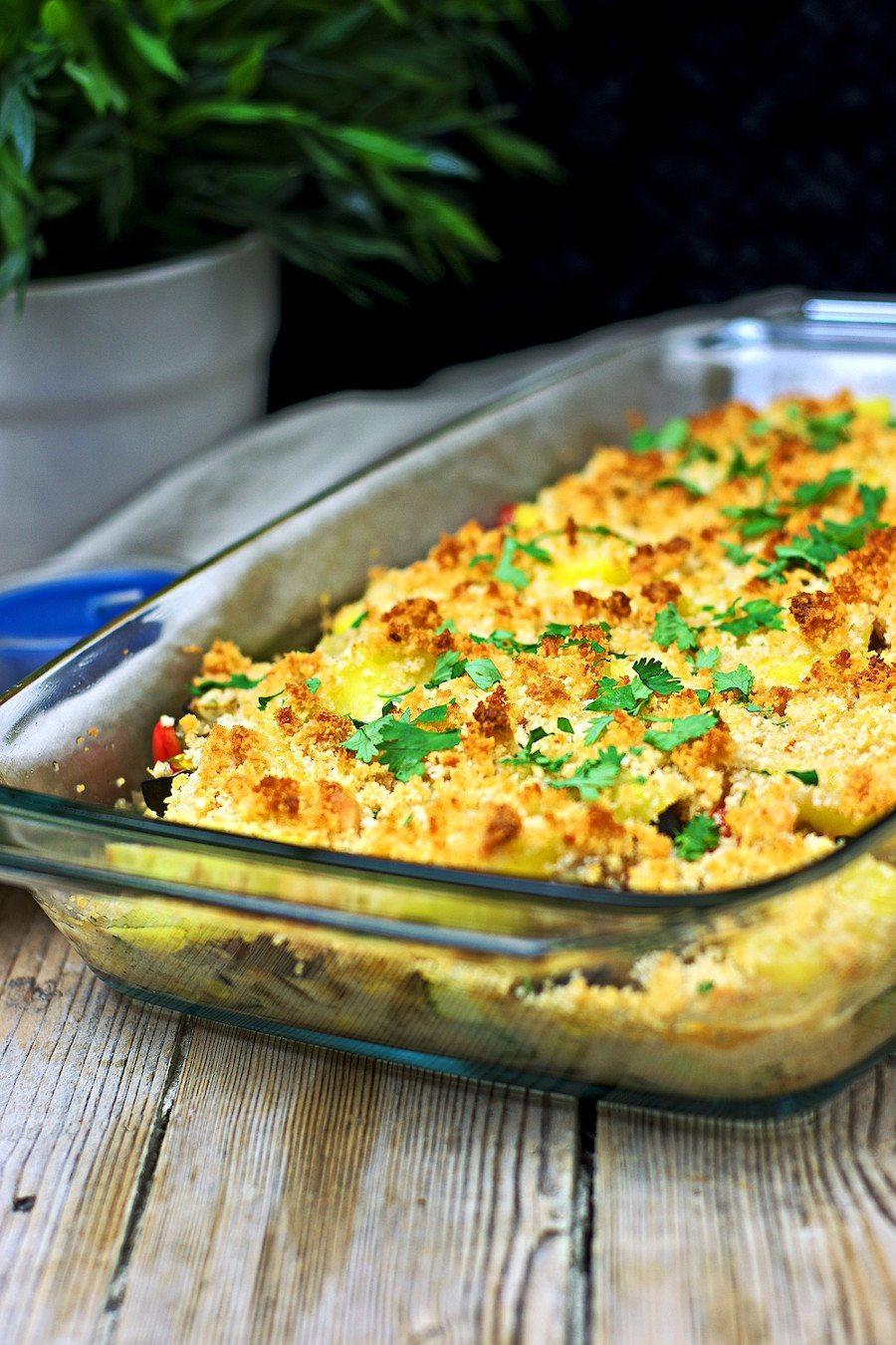 Golden baked Vegan Potato Casserole in a glass casserole.