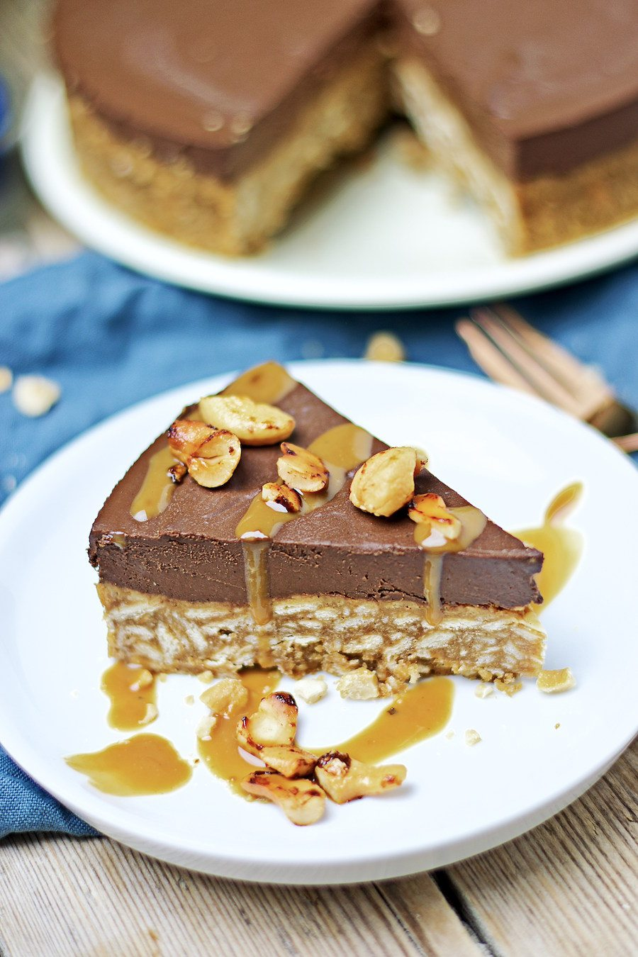 Near view focusing on the roasted cashews and caramel sauce as topping of the Vegan Chocolate Cake
