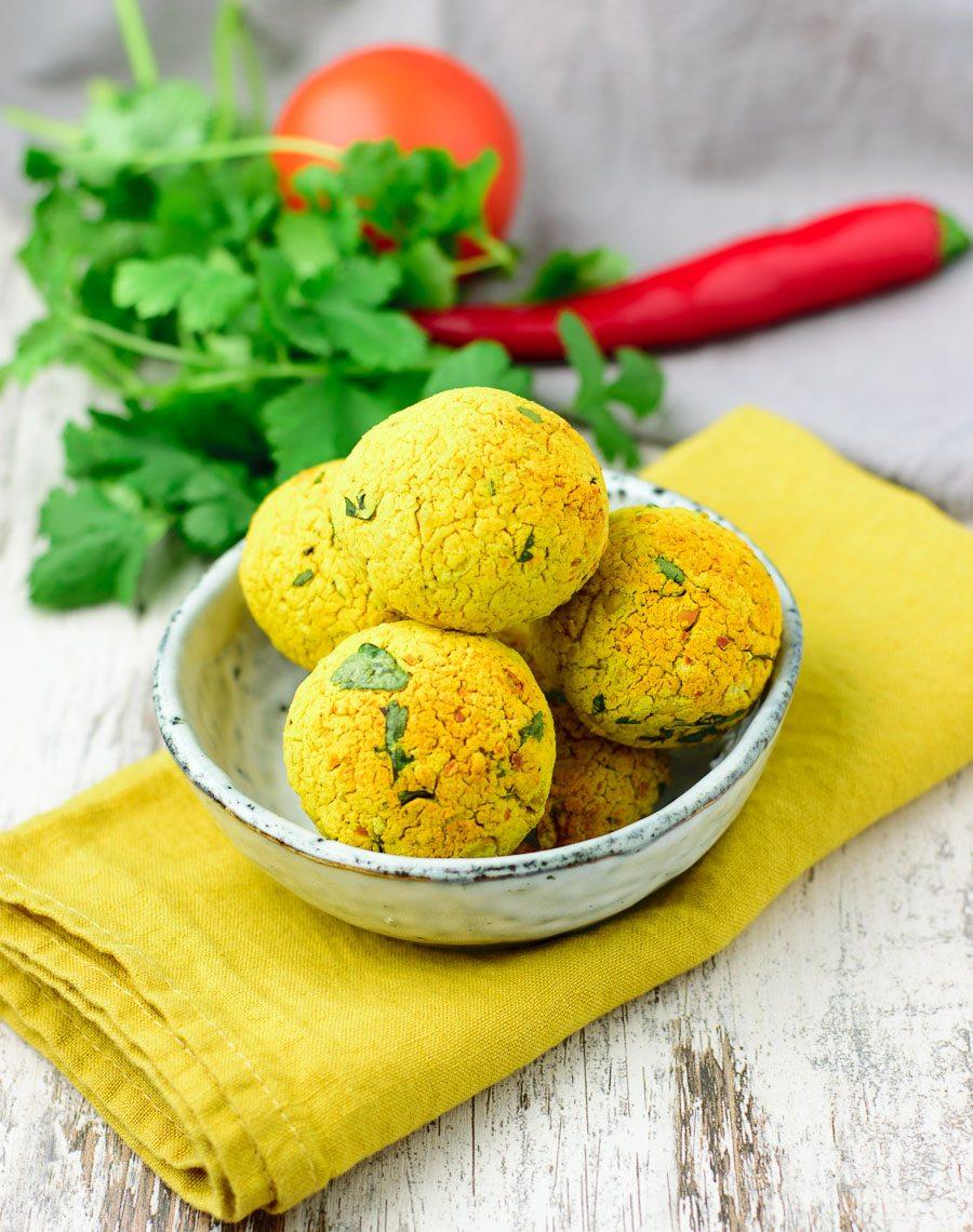 Small bowl with five turmeric falafel balls.