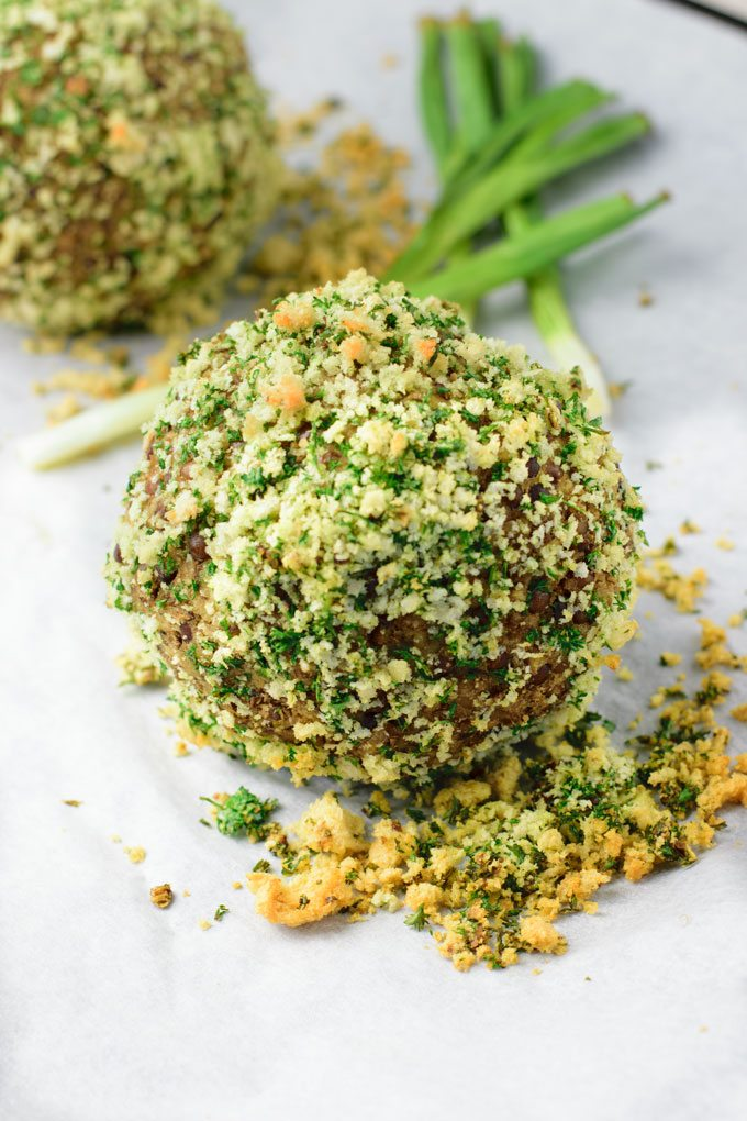 Closeup on a Scotch Egg Vegan Style before baking, covered in bread crumbs.