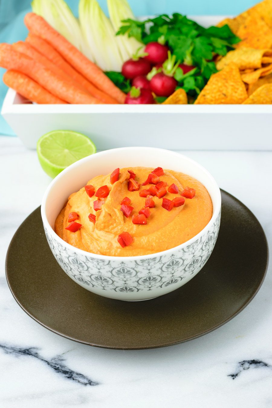 Bowl of the Easy Vegan Pimento Cheese garnished with diced bell pepper.