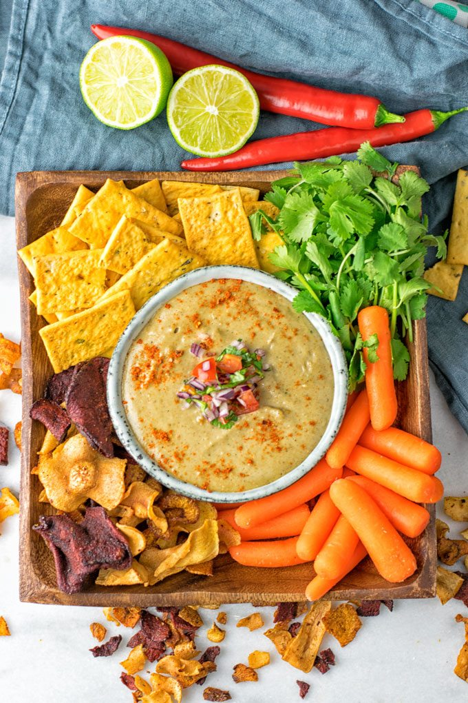 Top view on the Mexican Cheese Dip with snacks.