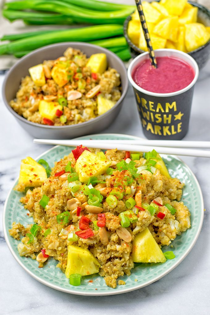 A plate and a bowl of the Thai Green Curry Detox Cauliflower Rice.