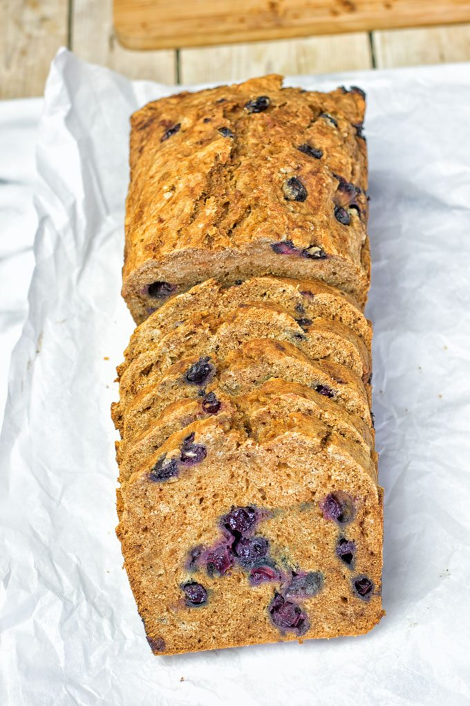 Gluten-Free Blueberry Bread slices on parchment paper.