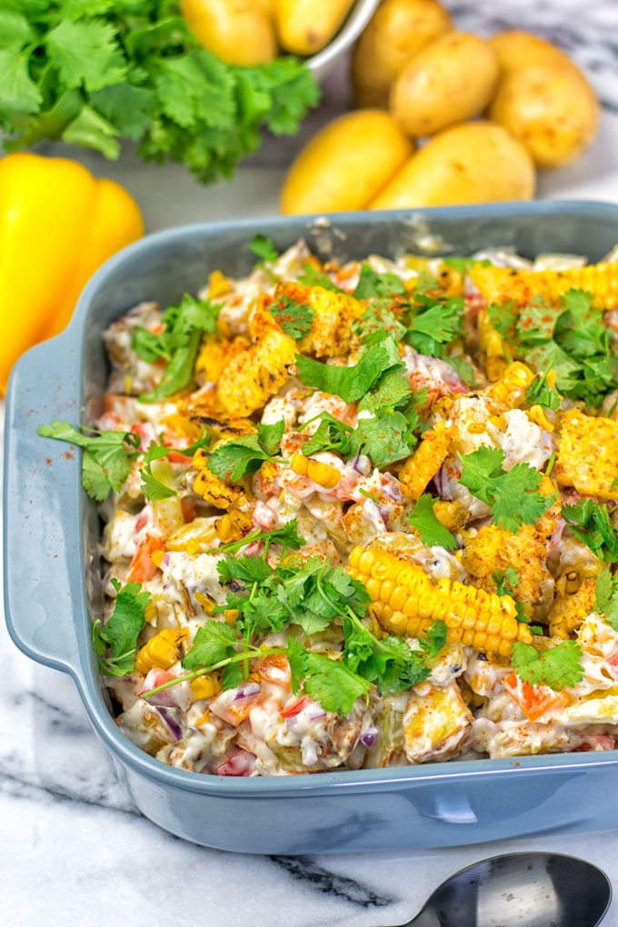 A dish filled with the Mexican Street Corn Potato Salad