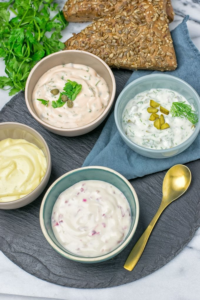 Four versions of the Vegan Tartar Sauce in small bowls.