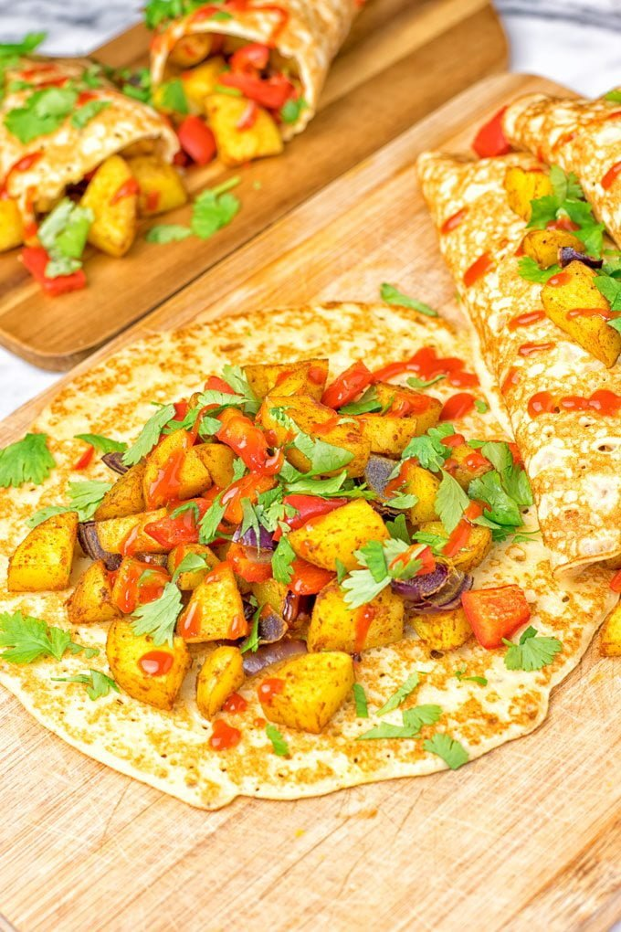 Open spicy Potato Breakfast Pancakes on a bord.