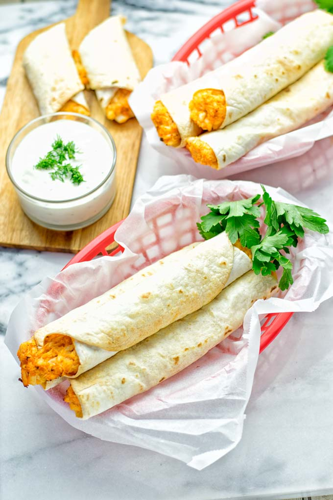 These Buffalo Cauliflower Taquitos are the ultimate comfort food. Vegan, gluten free, super easy to make and insanely delicious. An amazing dairy free alternative for dinner, lunch, potluck, party, meal prep, work lunch option. Once you'll try these, they will go into your daily rotation. #vegan #glutenfree #vegetarian #dairyfree #plantbased #contentednesscooking #lunch #dinner #mealprep #worklunchideas #taquitos #buffalocauliflower #easyfood #budgetfriendly #makeahedmeals #cauliflower