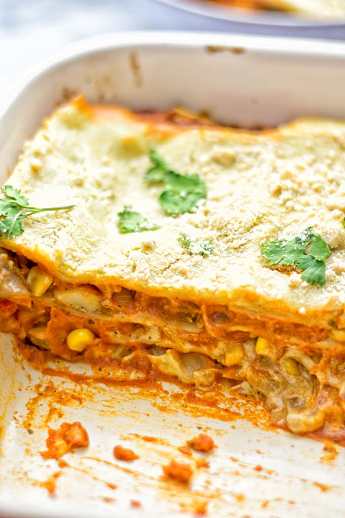 Super easy and delicious: This Enchilada Lasagna is naturally vegan, gluten free and a winning combination for any food lover. An amazing dairy free lunch, dinner, meal prep, work lunch and easy family dinner that will blow you away with just the right amount of flavor and spices. Come and try this fantastic dairy free alternative now, so good! #vegan #glutenfree #vegetarian #dairyfree #enchilada #lasagna #mealprep #worklunchideas #contentednesscooking #dinner #lunch #easyfamilyrecipes #easyfood