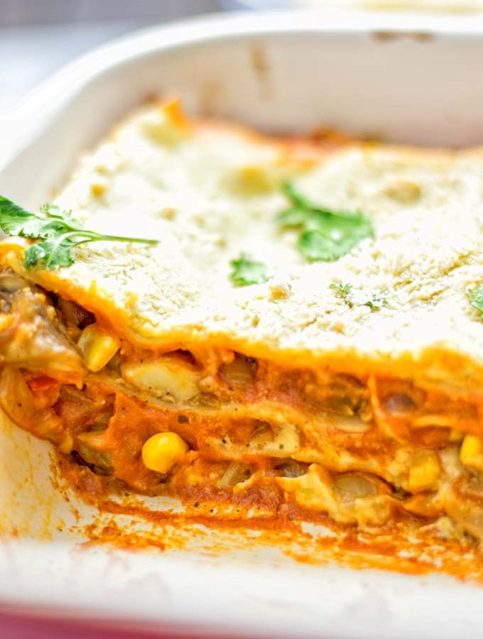 Super easy and fingerlicking delicious: This Enchilada Lasagna is naturally vegan gluten free and a winning combination for any good food lover. An amazing dairy free lunch, dinner, meal prep, work lunch and easy family dinner that will blow you away with just the right amount of flavors and spices. Come and try this fantastic dairy free alternative now, so good! #vegan #glutenfree #vegetarian #dairyfree #enchilada #lasagna #mealprep #worklunchideas #contentednesscooking #dinner #lunch #easyfamilyrecipes #easyfood