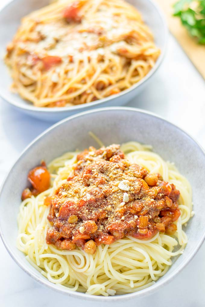 This Chickpea Lentil Bolognese is naturally vegan, gluten free and so super easy to make in one pot. It's amazing over your favorite pasta for dinner, lunch, meal preparation or a great dairy free alternative for work lunch. #vegan #glutenfree #dairyfree #vegetarian #onepotmeals #dinner #lunch #mealprep #worklunchideas #chickpeas #lentils #chickpeabolognese #lentilbolognese #contentednesscooking