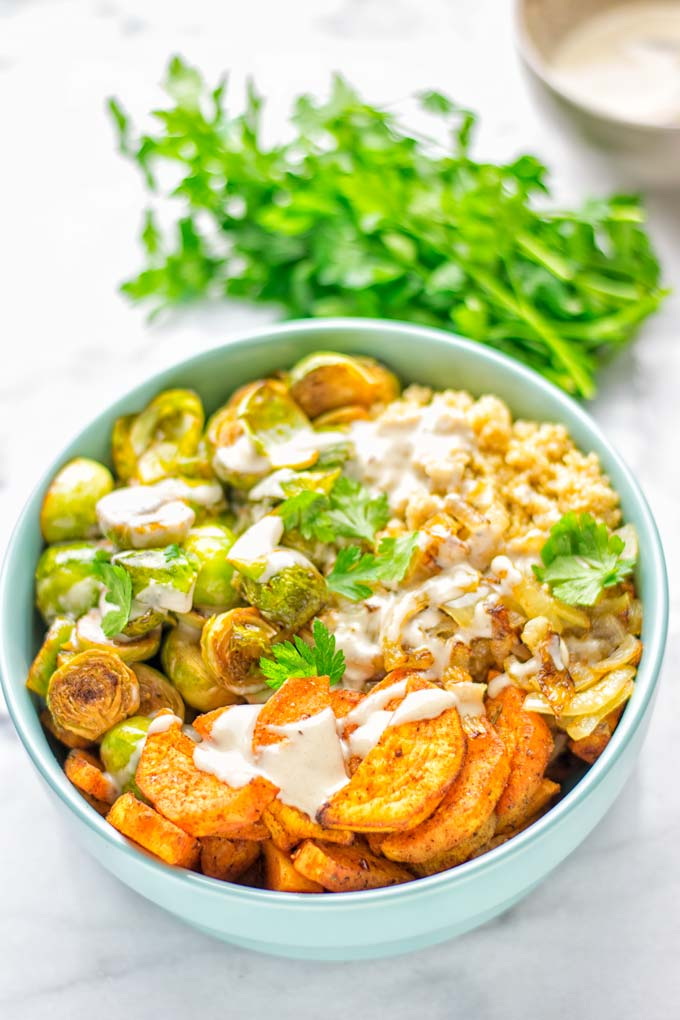 This Cajun Sweet Potato Brussels Sprout Salad is naturally vegan, gluten free and super easy to make. It's so delicious for lunch, dinner, meal prep, work lunch, holidays and Christmas. Try it now, make this keeper again and again. #vegan #glutenfree #dairyfree #vegetarian #contentednesscooking #mealprep #worklunchideas #dinner #lunch #brusselsproutsalad #cajunsweetpotatoes #holidayfood #christmasrecipes #roastedbrusselssprouts #christmasfood #holidayrecipes