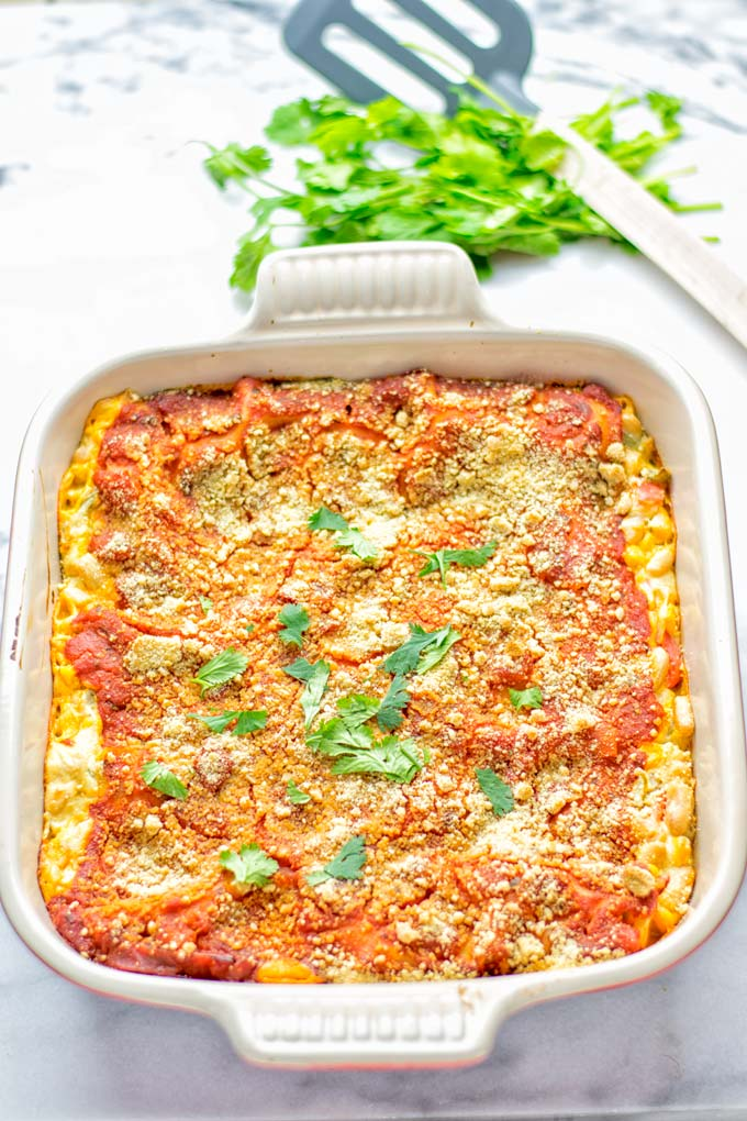 Super easy and insanely delicious White Chili Lasagna. Entirely vegan, gluten free and seriously so addictive. It's fantastic for dinner, lunch, meal preparation, work lunch that the whole family will love. Also a keeper for the holidays and date night. If you're looking for an easy lasagna recipe try this, now. #vegan #dairyfree #glutenfree #vegetarian #lasagna #mealprep #worklunchideas #whitechili #whitechilirecipes #holidays #dinner #lunch #datenightrecipesdinner #contentednesscooking