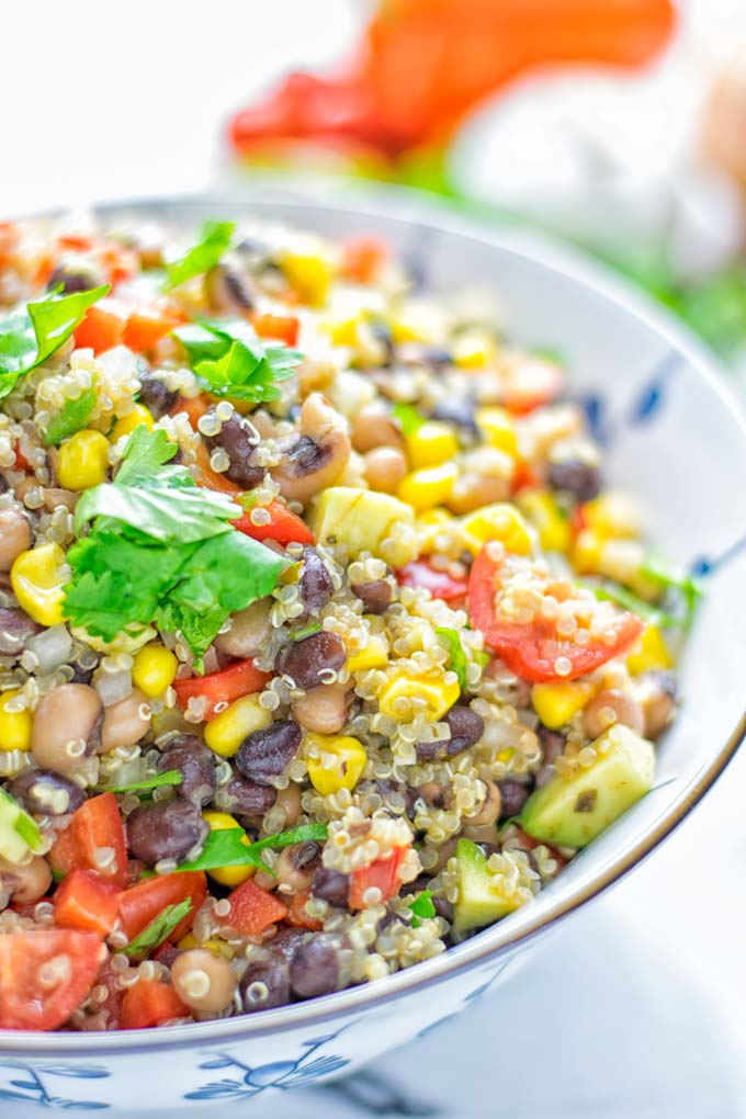 This Cowboy Caviar Quinoa Salad is naturally vegan, gluten free, and so satisfying. It has all the flavors you'll love and is super easy to make for dinner, lunch, meal prep and so much more. Enjoy and try it now You'll know how easy it can be. #vegan #glutenfree #dairyfree #vegetarian #cowboycaviar #quinoasalad #dinner #lunch #mealprep #worklunchideas #contentednesscooking #healthymeals #newyearhealthyeating #potluckideas #partyfood