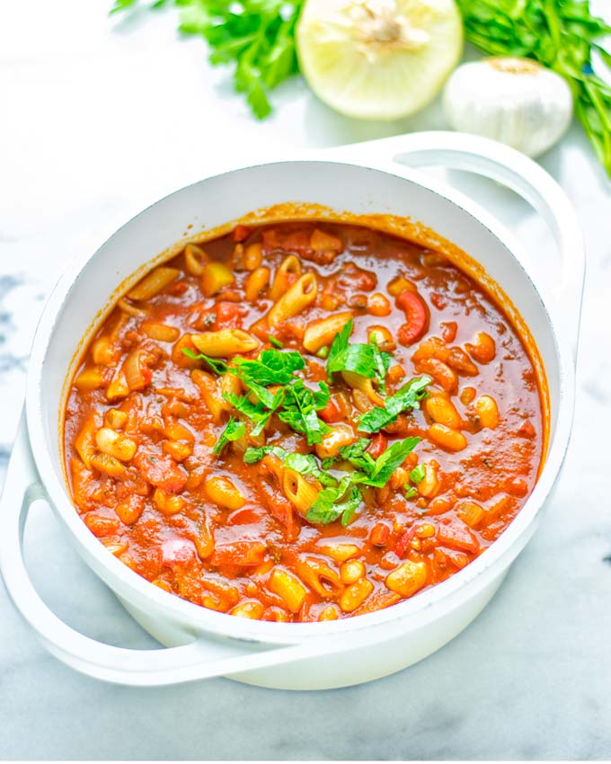 This Pasta Fagioli Soup is super easy to make in one pot and entirely vegan, gluten free. It's packed with so many delicious flavors and perfect for dinner, lunch, meal prep, work lunch and so much more. Try it and learn how easy it can be to make food for the whole family. #vegan #glutenfree #dairyfree #onepotmeals #vegetarian #contentednesscooking #mealprep #worklunchideas #dinner #lunch #pastafagiolisoup #20minutemeals