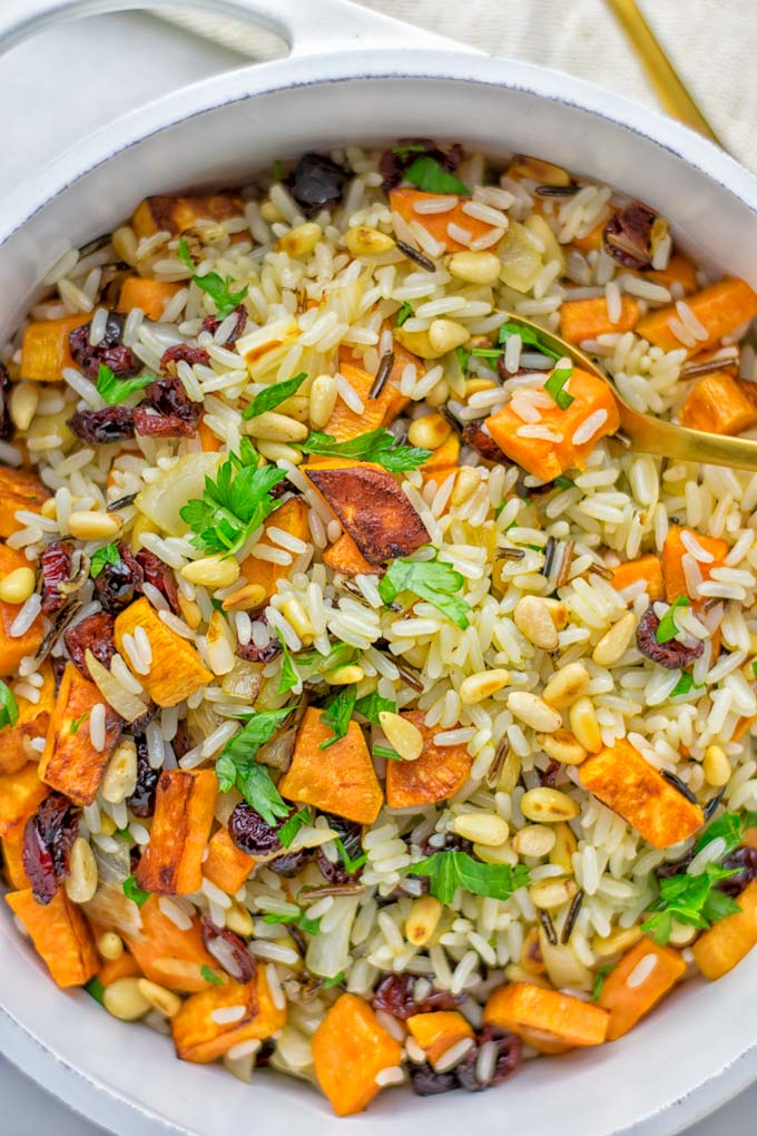 This Wild Rice Pilaf is a super easy and tasty one pot meal. Naturally vegan, gluten free it has all the flavors you love and want for Christmas and the whole year. Try it now for dinner, lunch, meal prep, wow your guests and family. #vegan #glutenfree #dairyfree #vegetarian #christmasfood #dinner #lunch #onepotmeals #holidayfood #wildricepilaf #ricepilafeasy #worklunchideas #contentednesscooking #mealprep