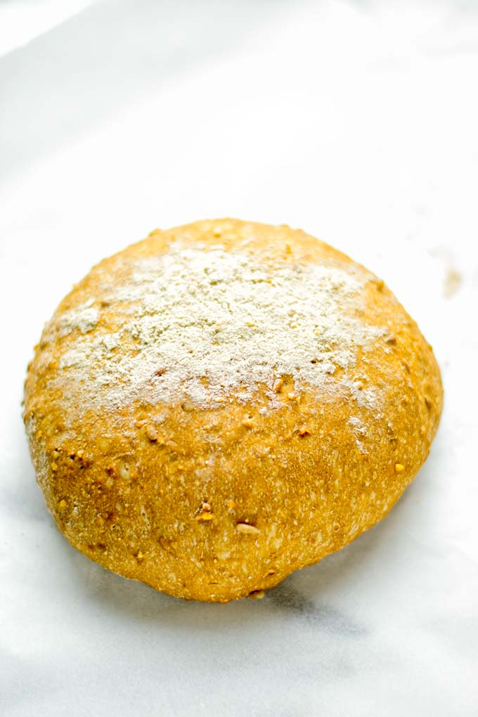 This Artisan Bread is naturally vegan, gluten free and made in the Dutch oven. It's easy to prepare in one bowl and the result will be impressive. Trust me there is nothing better than fresh homemade bread from the oven. This is perfect for breakfast, lunch and even dinner. Try this for your family and everyone will love it. #vegan #dairyfree #glutenfree #contentednesscooking #breakfast #dinner #lunch #artisanbread #nokneadbread #dutchovenbread #homemadebread #kidfriendlymeals #budgetmeals