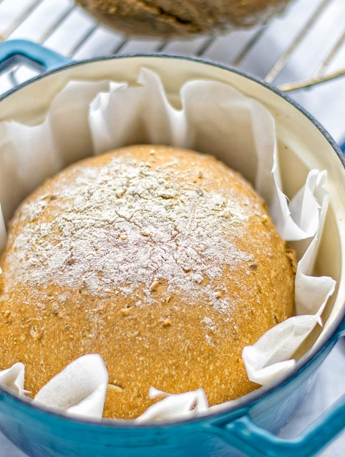 This Artisan Bread is naturally vegan, gluten free and made in the Dutch oven. It's super easy to prepare in one bowl and the result will be impressive. Trust me there is nothing better than fresh homemade bread from the oven. This keeper is perfect for breakfast, lunch and even dinner. Try this for your family and everyone will love it. #vegan #dairyfree #glutenfree #contentednesscooking #breakfast #dinner #lunch #artisanbread #nokneadbread #dutchovenbread #homemadebread #kidfriendlymeals #budgetmeals