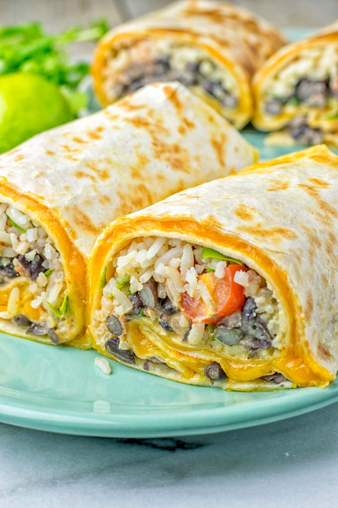 This Rice and Beans Quesarito is entirelly vegan, gluten free and so easy to make. It's cheesy, incredibly satisfying and so delicious for dinner, lunch, meal prep (reheat beautifully) and amazing for work lunches. An amazing dairy free alternative for everyone that the whole family will love. #vegan #glutenfree #dairyfree #vegetarian #contentednesscooking #quesarito #riceandbeans #dinner #lunch #worklunchideas #mealprep #quesadila #burrito