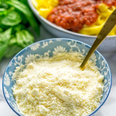 This Vegan Parmesan Cheese is made with super simple 3 ingredients in 1 minute. Trust me you really want this recipe - so versatile for all your pasta, casseroles, salads and so much more. It's a keeper for lunch, dinner, meal prep, work lunch that the whole family will love. #vegan #dairyfree #glutenfree #dinner #lunch #mealprep #worklunchideas #contentednesscooking #veganparmesancheese #pasta #pizza #casseroles #salads #familyfoodideas