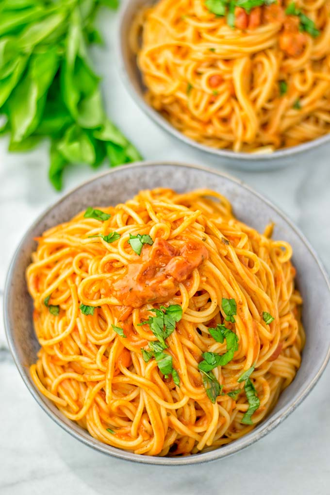instant pot spaghetti recipe topped with fresh basil