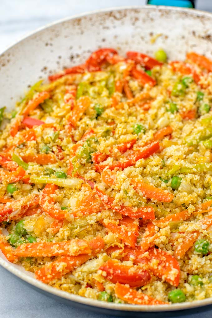 Cauliflower Fried Rice as it is being made in a pan.