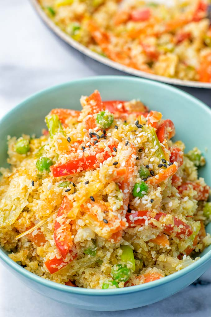 Portion of Cauliflower Fried Rice in a light blue bowl.