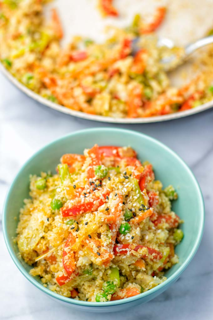 Pan and small bowl of prepared fried rice.