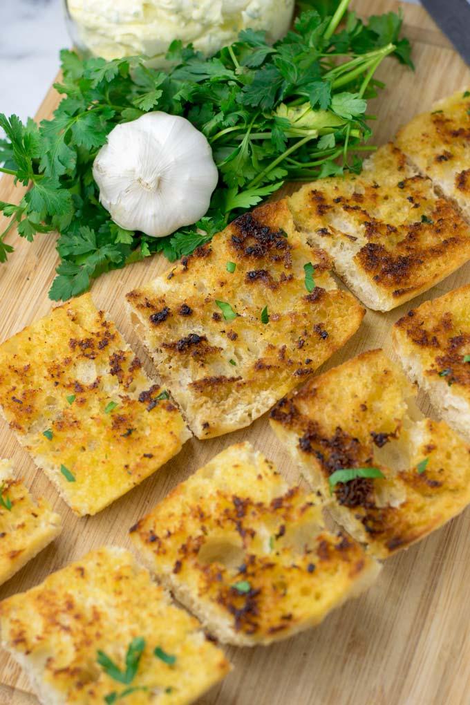 Sprinkling parse;y over the Garlic Bread.