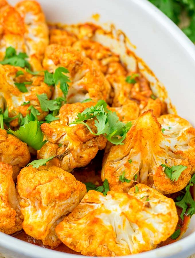 BUffalo Cauliflower decorated with cilantro.