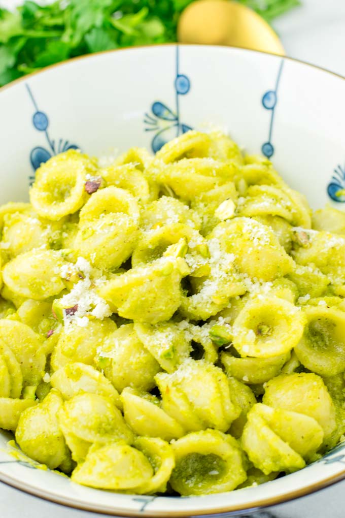 Closeup of Parmesan covered pistachio pesto pasta.