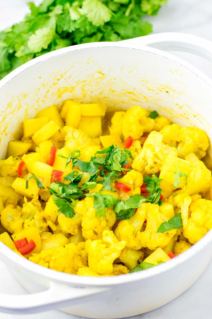 Family portion of Aloo Gobi is sprinkled with cilantro.