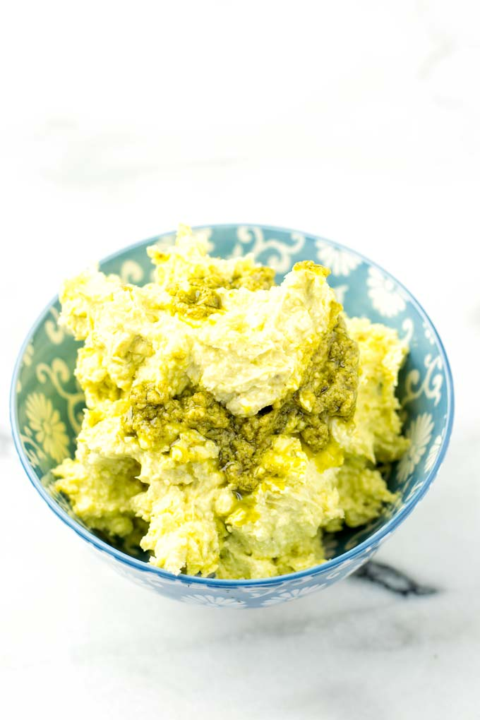 Close view of the pesto butter in a blue bowl.