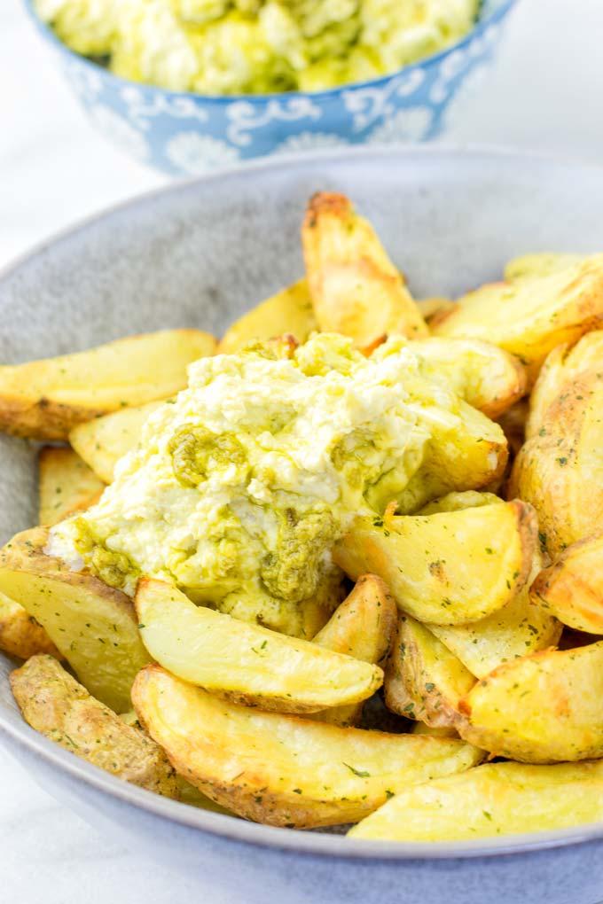 Melting butter over potato fries.