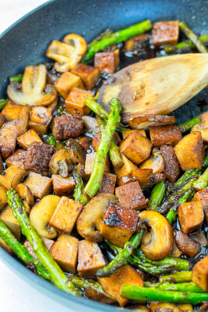 The Asparagus Stir Fry is made with tofu and mushrooms.