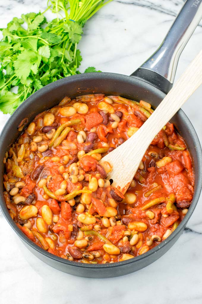 These homemade Ranch Style Beans are are made with four kinds of beans to create the perfect texture. Super easy to make in one pot, crockpot ready, and seriously so easy plus delicious! Naturally vegan, gluten free once you've tried it, you want coming back for in no time. A keeper that the whole family will love, even the pickiest kids.