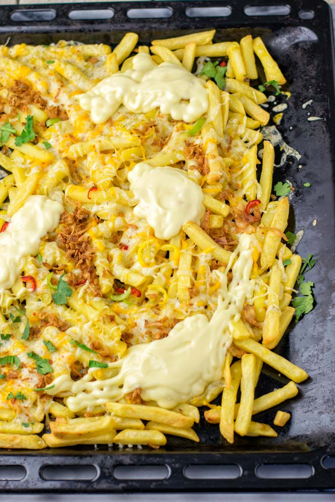Single sheet pan for the oven, filled with loaded fries.
