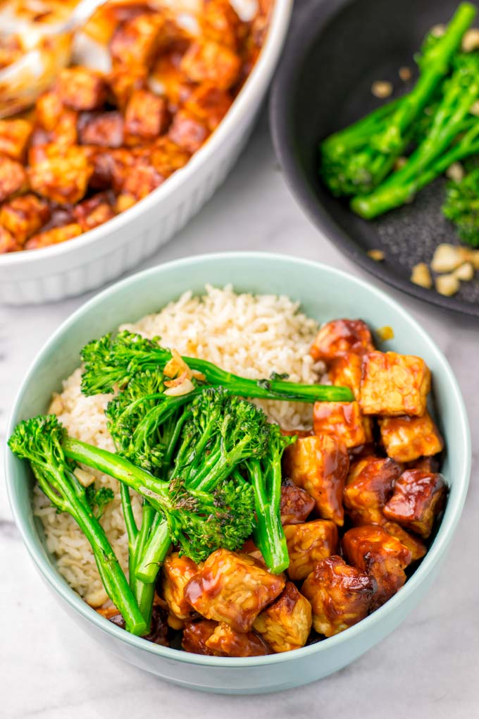 Large bowl with rice, tempeh marianted in BBQ sauce, and pan roasted broccoli.