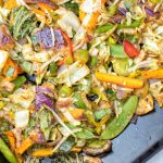 Cabbage, sugar snaps, and carrots are among the veggies on this sheet pan.