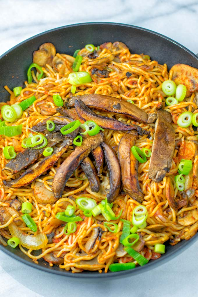 Wok noodles, mushrooms, onions, and green onions are needed.