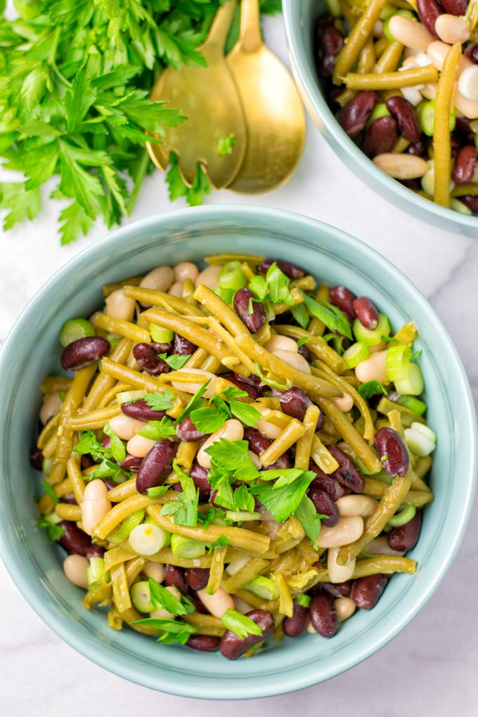 Fresh parsley is used to decorate this easy bean salad.
