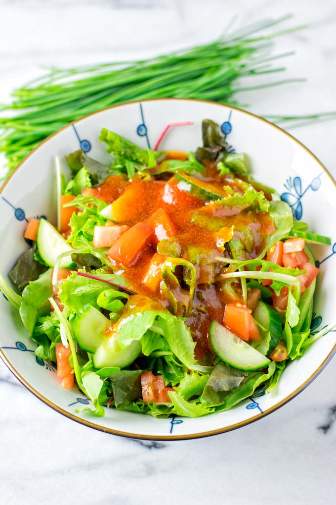 Mix dressing and the salad in a bowl.