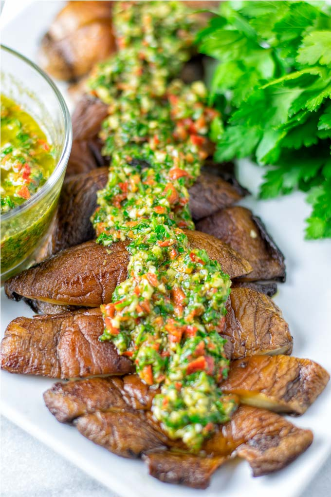 Chimichurri Sauce is given over Portobello mushrrom steak strips.