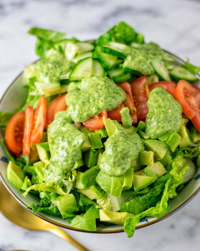 The dressing used over a fresh, mixed salad.