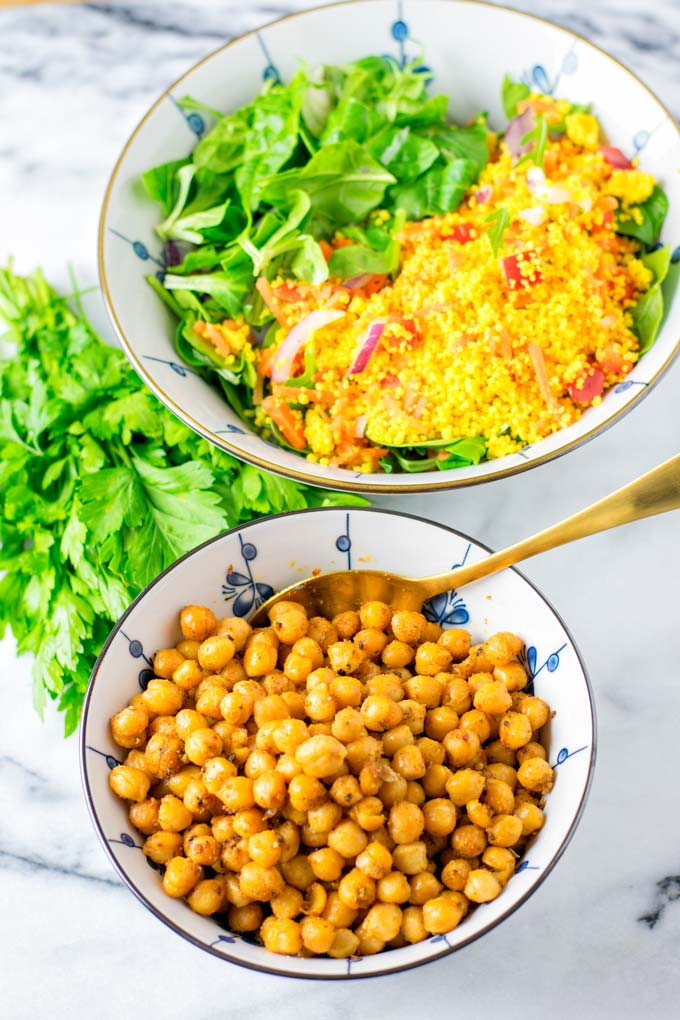 Bowl of Roasted Chickpeas with a fresh mixed lunch salad in the background.