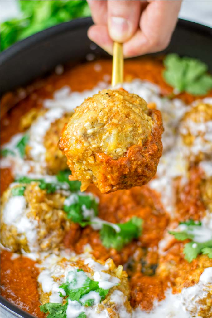 One ball of the Malai Kofta on a golden spoon
